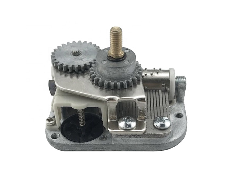 Miniature 18 note musical movement music box with center output shaft