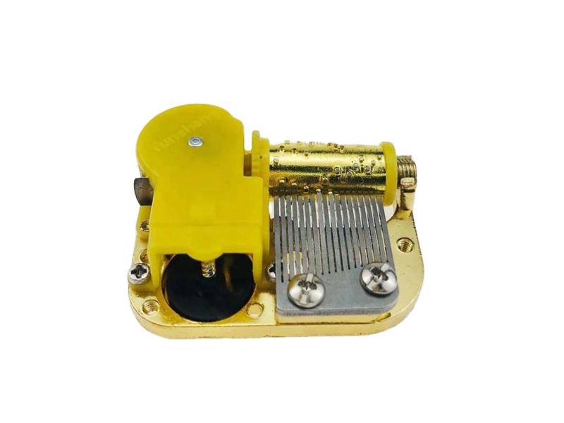 Gold 18 note miniature music movement
